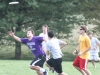 Junior Clark Grube (left) sprints to catch the frisbee, while junior Jordan Flagler (center, grey T-shirt) attempt to stop him. Junior Kevin Davies (right, yellow T-shirt) patiently awaits for his teammate to receieve the frisbee.