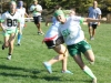 Senior Susan Cumpston (right) dodges junior Amanda Reid (center) on her way to the end zone.  Cumpston scored one  of the two touchdowns for the seniors.