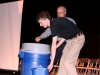 Senior Nick Henninger assists Dr. Lazor in showing JC students the recycling bins avaliable in school.