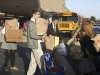 Students carry bags full of donated items for Grace Leung 's 