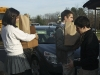 Students help load a car full of donations for the troops.
