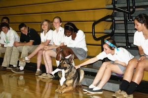 Officer, police dog demonstrate law enforcement for government class