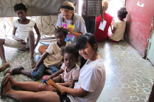 Senior helps at Haitian orphanage