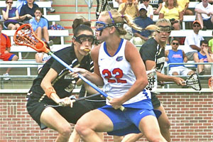 Alumni dominate collegiate lacrosse, wrestling